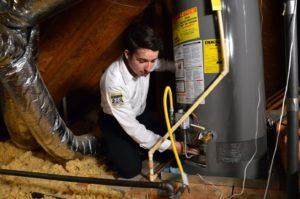 Plumber Checking Water Heater
