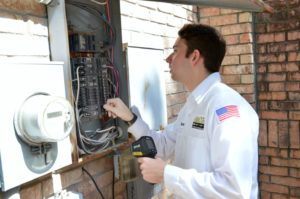 Electrician Checking Electrical Panel